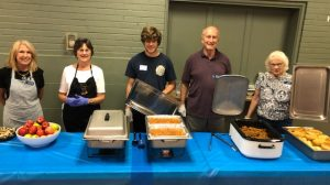 July Community Dinner Diners Enjoy a 4th of July Themed Meal